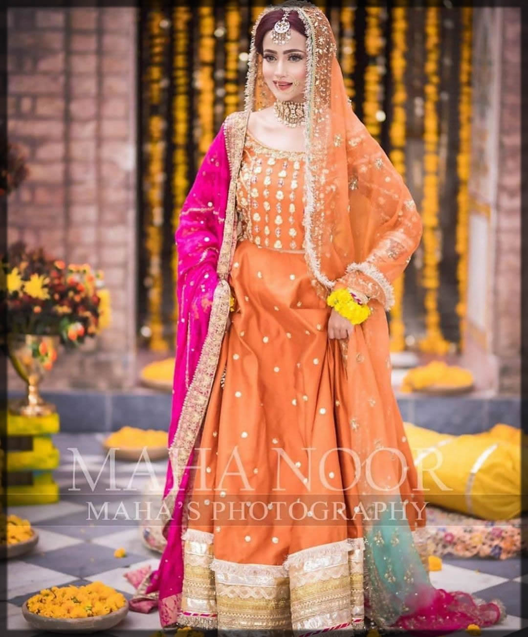 Orang Color Dress With Pink Duppata For The Mehndi Bridal