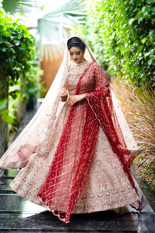 indian bridal lehenga in tea pink