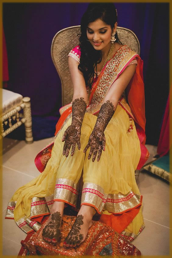 elegent mehndi design for yellow and pink dress