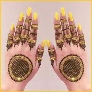 yellow glitter mehndi design for bride