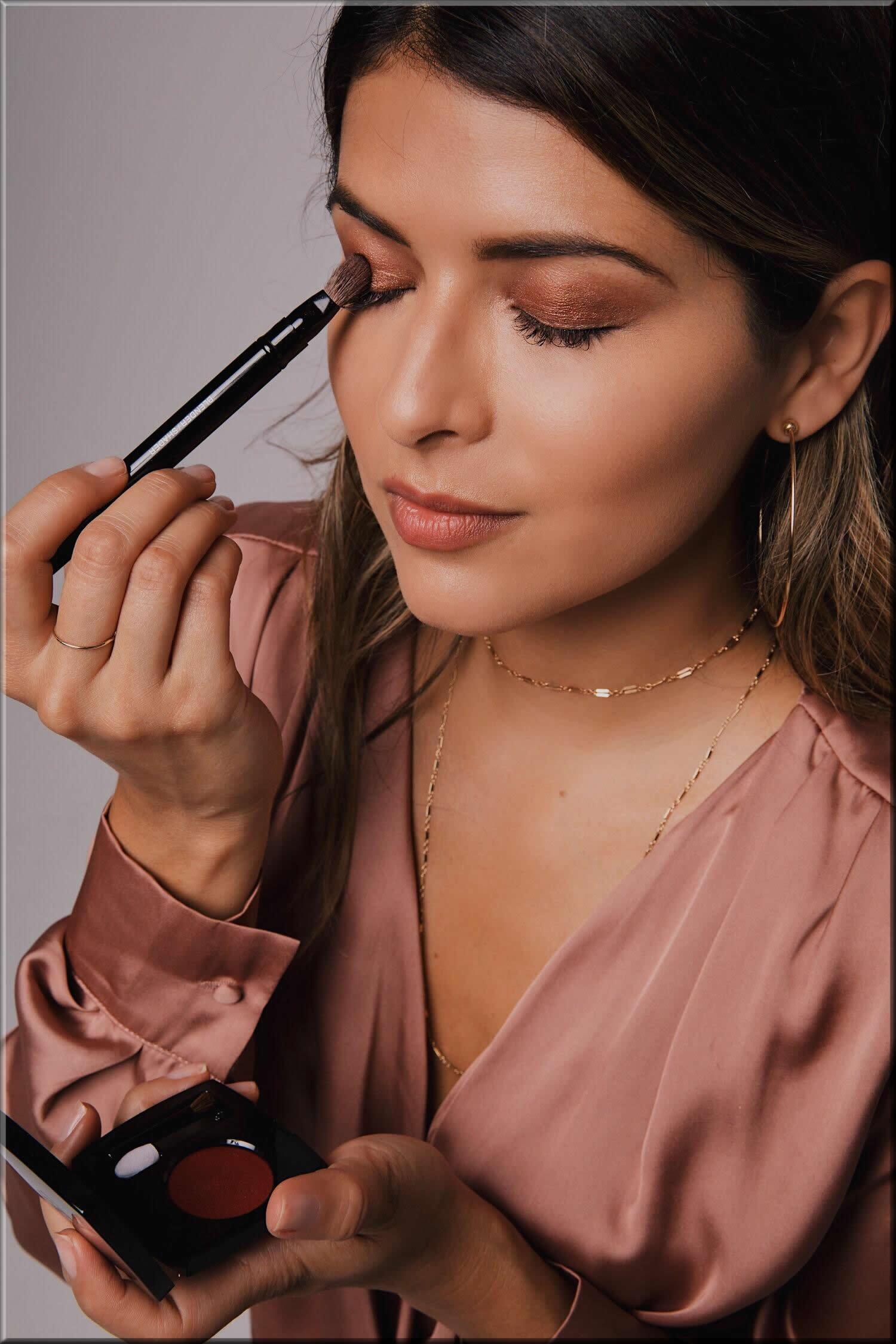 girl doing her makeup for eid