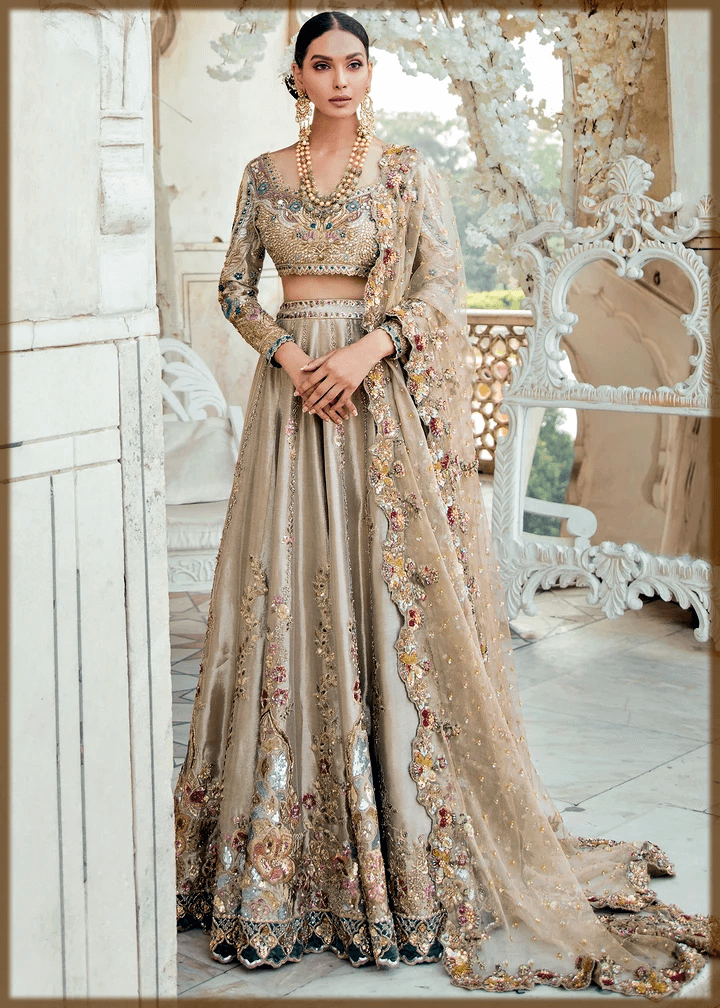 Dull gold choli embroidered with hues of lilac