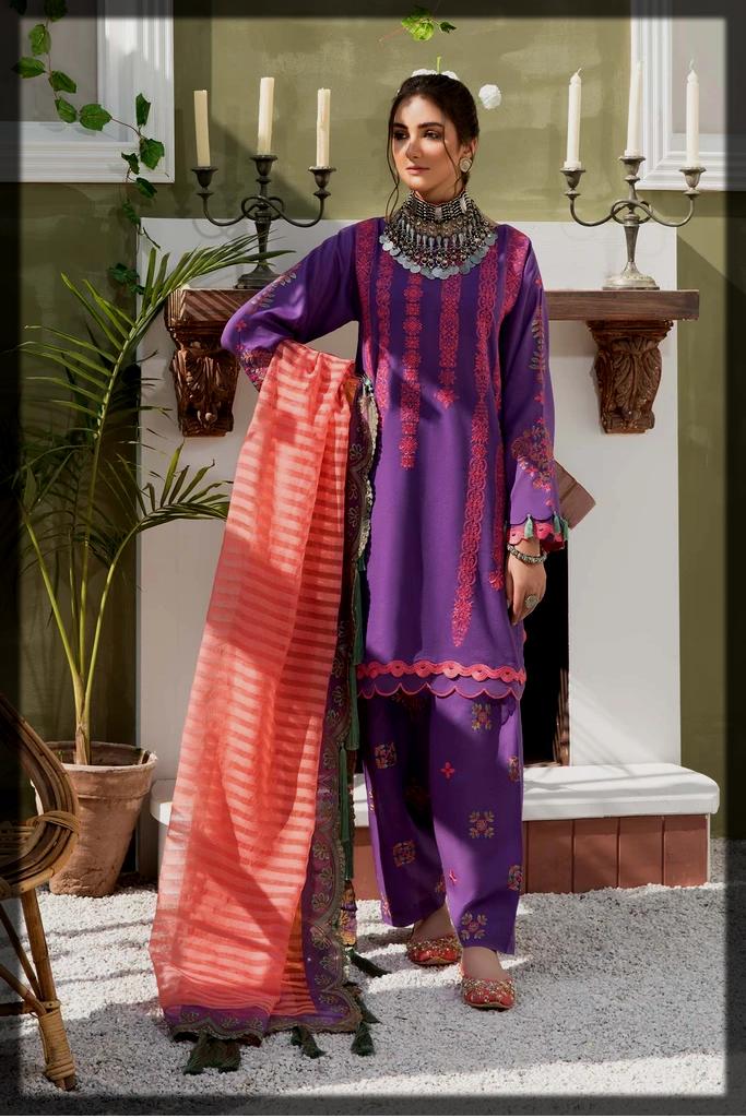 striking lawn karandi suit by charizma