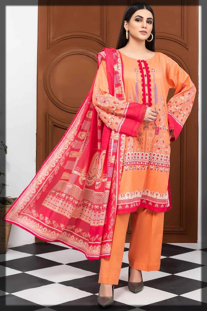 vibrant peach lawn printed suit
