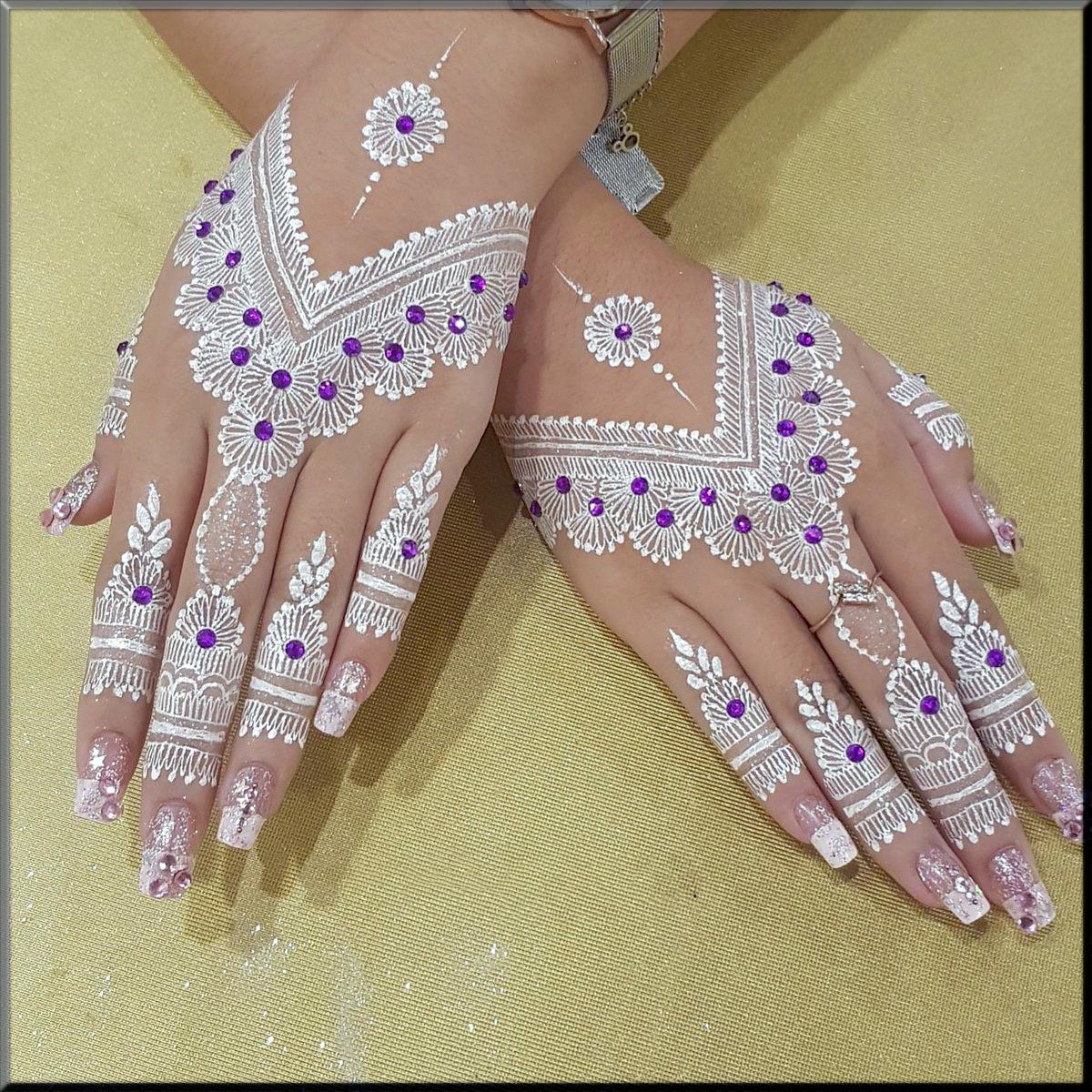 white mehndi with motifs