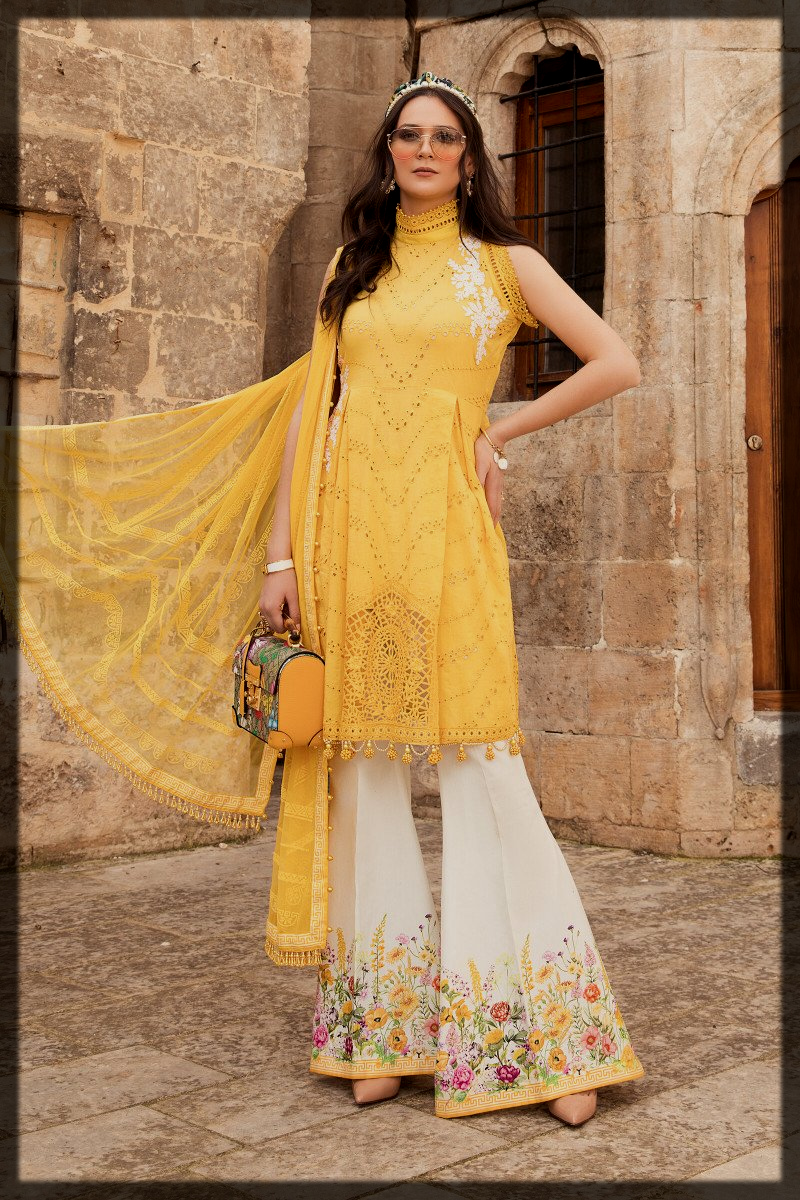 yellow and white party wear suit for women