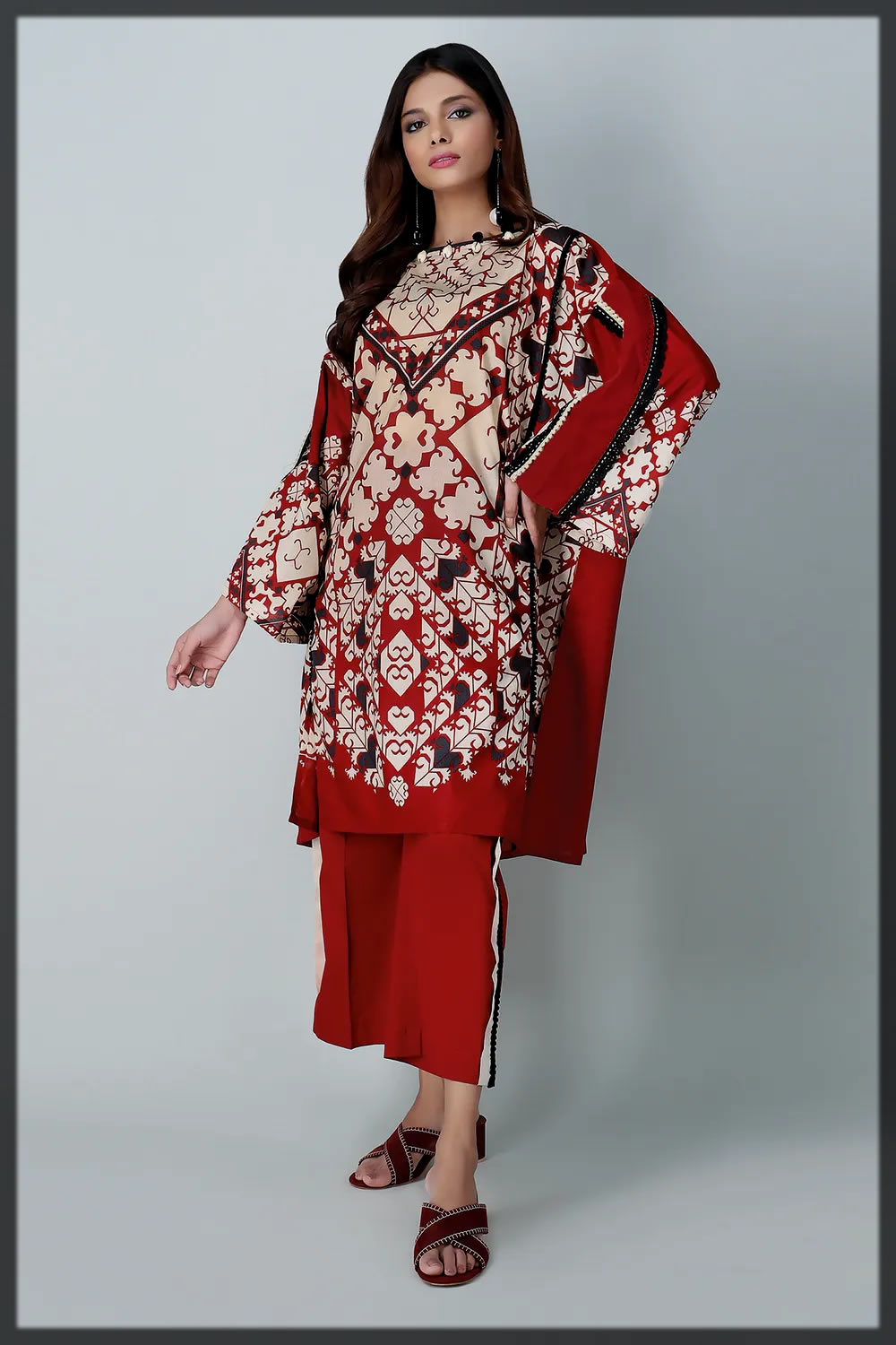 bold red 2 piece unstitched lawn outfit with stylized prints