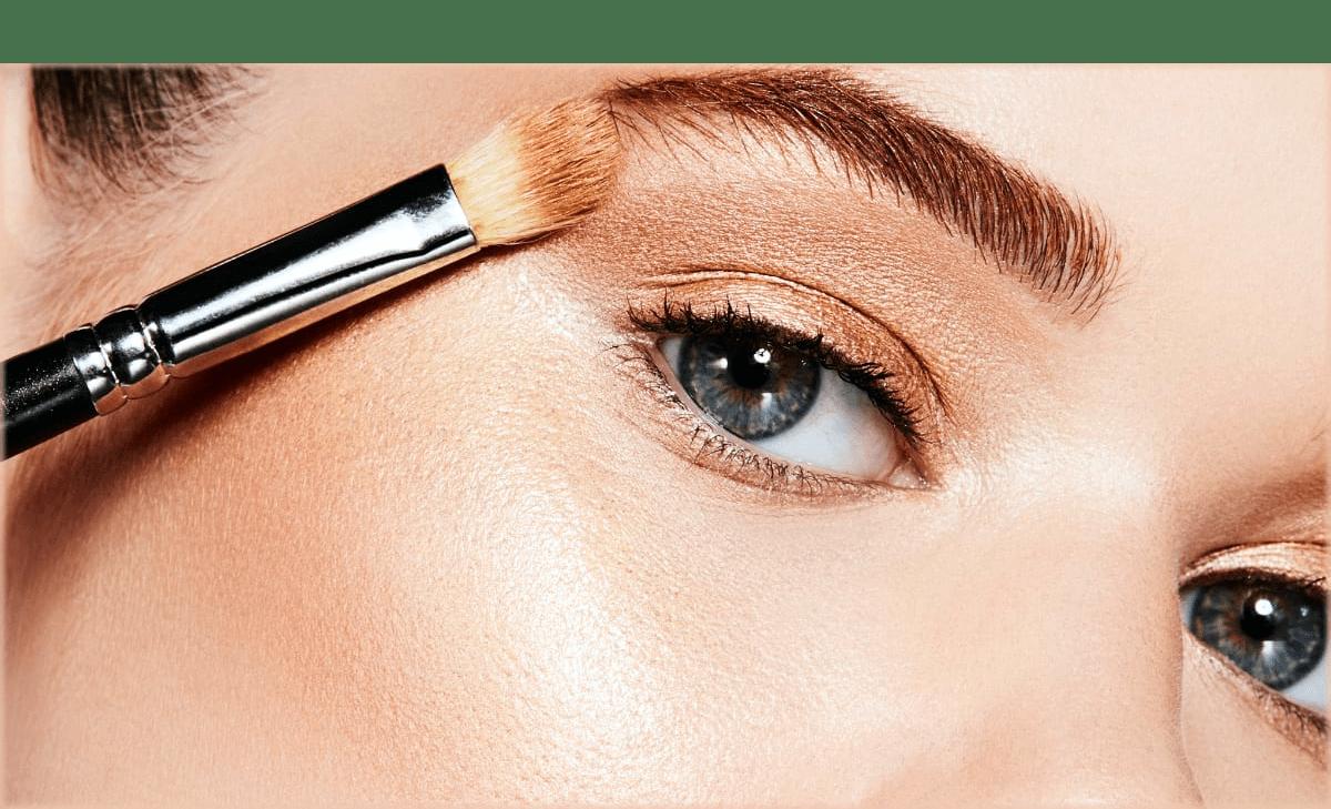 Applying highligter to make Eyes look bigger with makeup