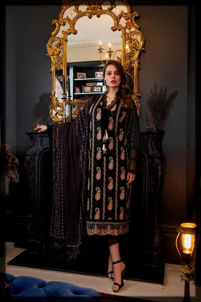 sleek black summer suit by Sobia Nazir