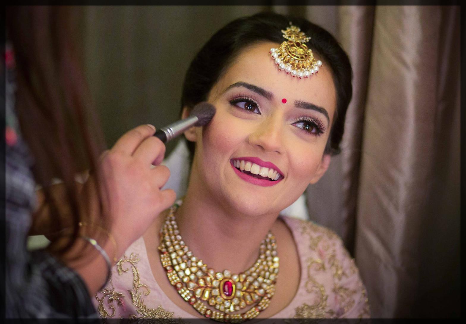 apply blush on the bride