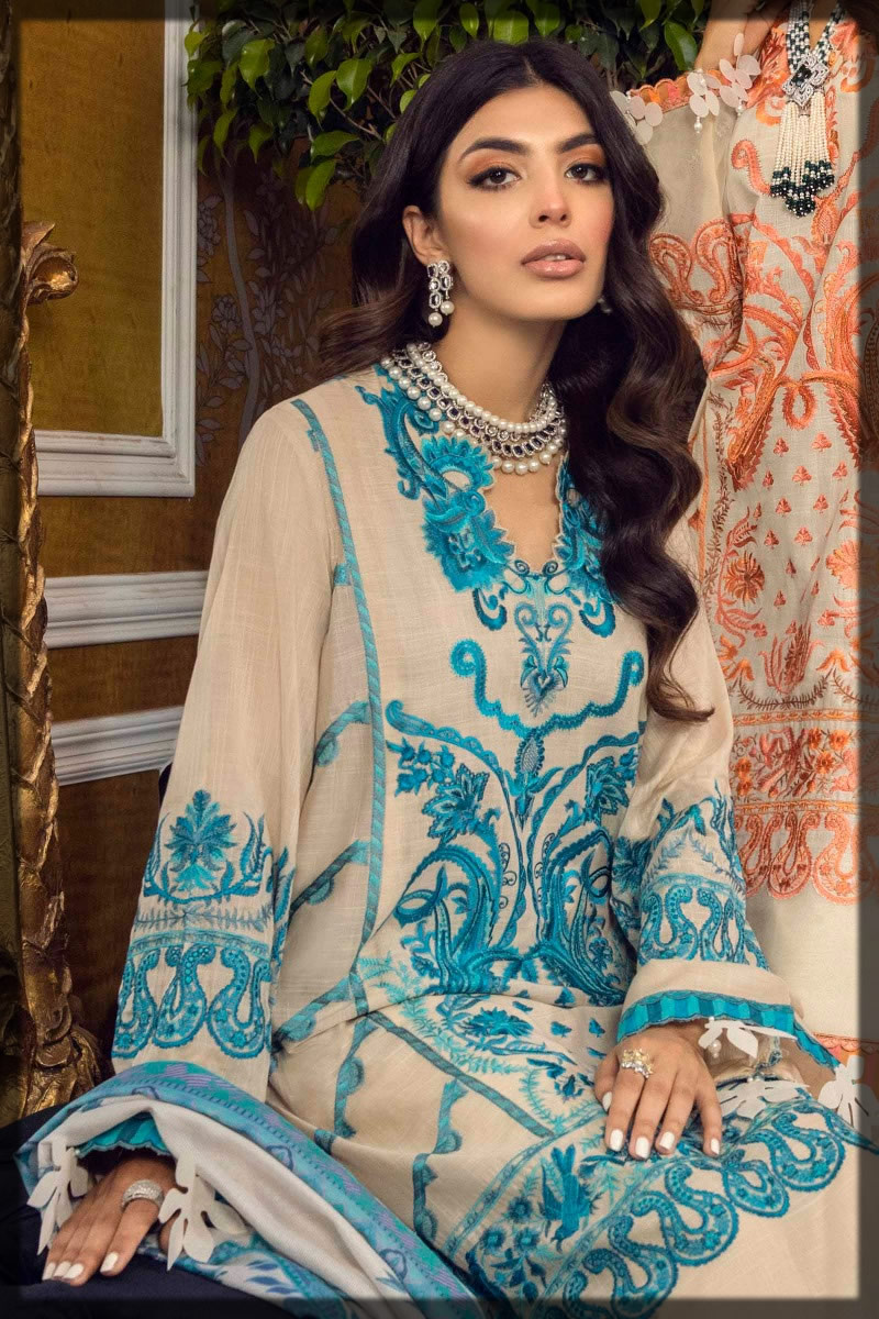 contrasting beige and blue embroidered suit
