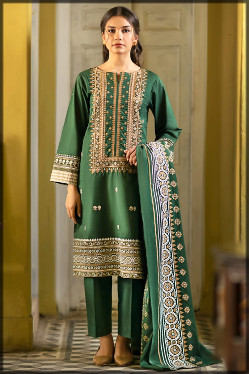 heavily embroidered dark green dress
