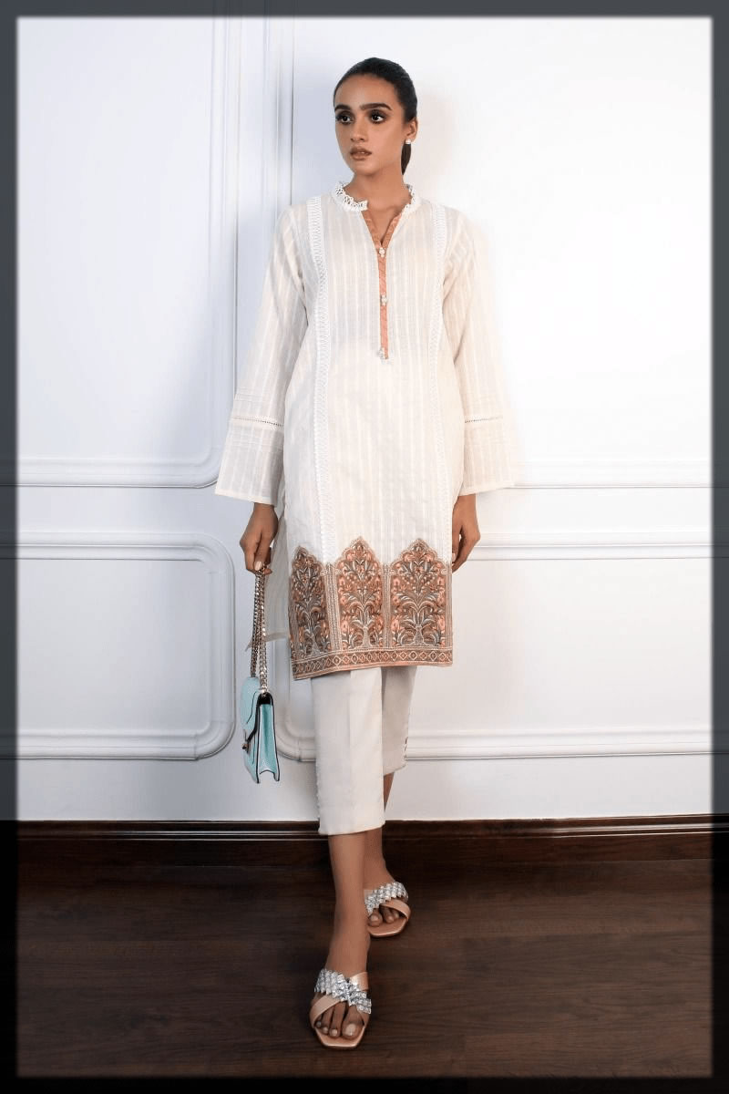 magnificant white kurta with trouser