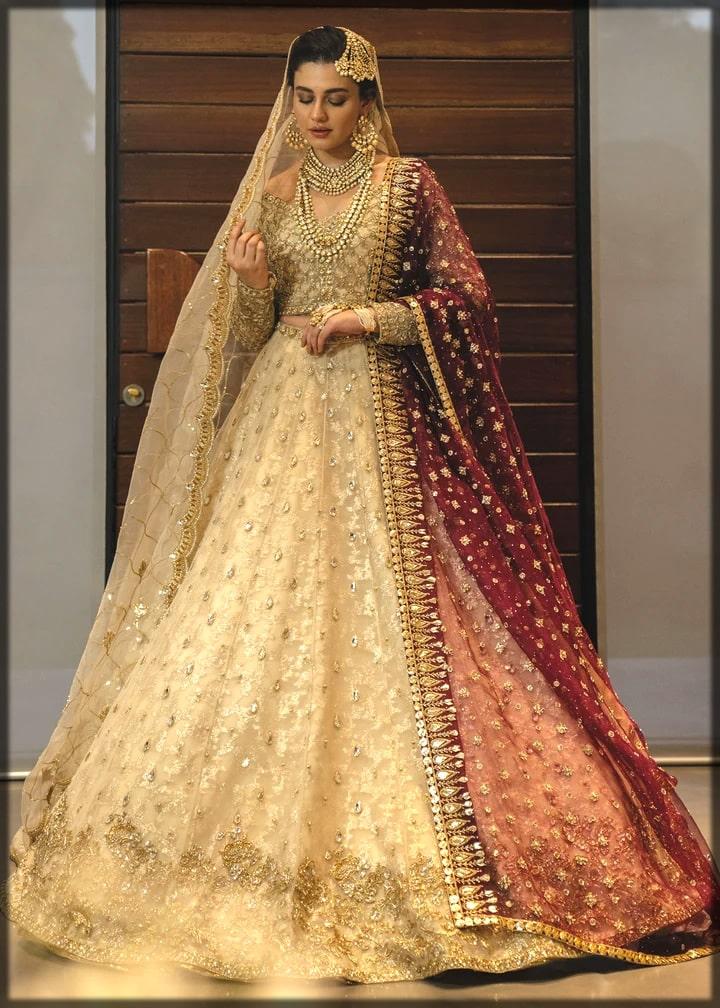nude color heavily embellished barat lehenga for brides