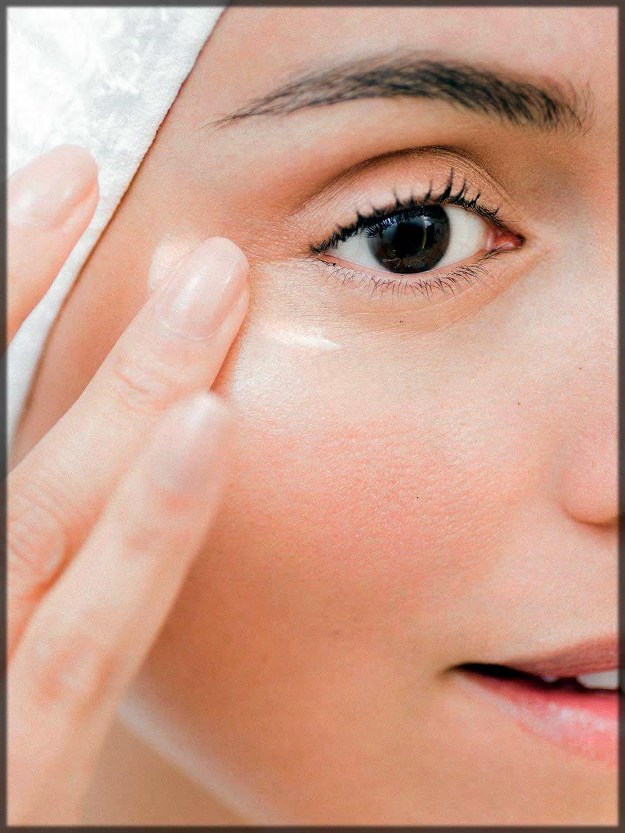 Applying eye cream for skin care