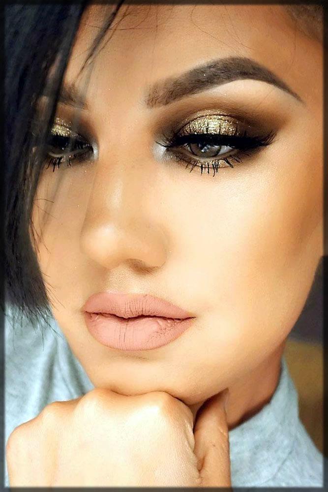 Beautiful make up look with golden smokey eyes