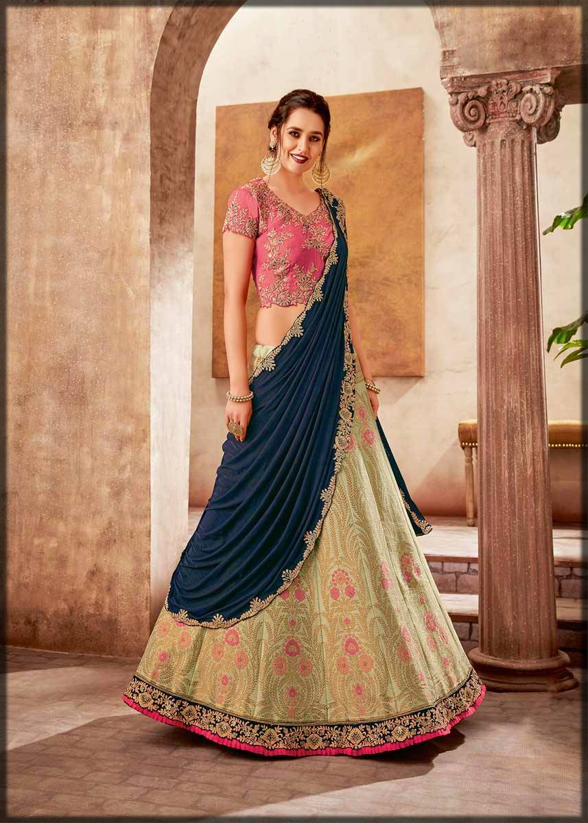 green weaved silk lehenga with zari work