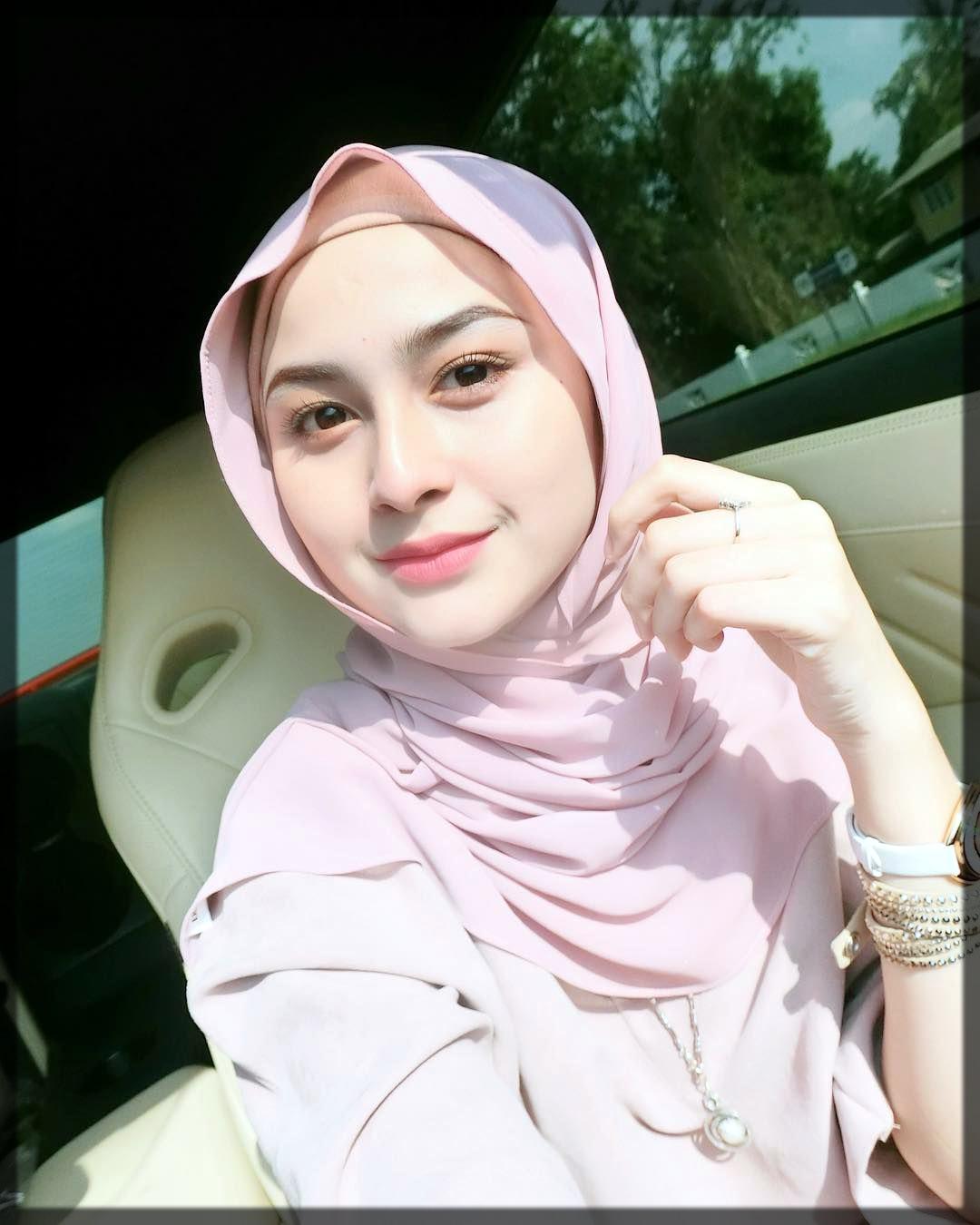 pink hijab with lavish makeup