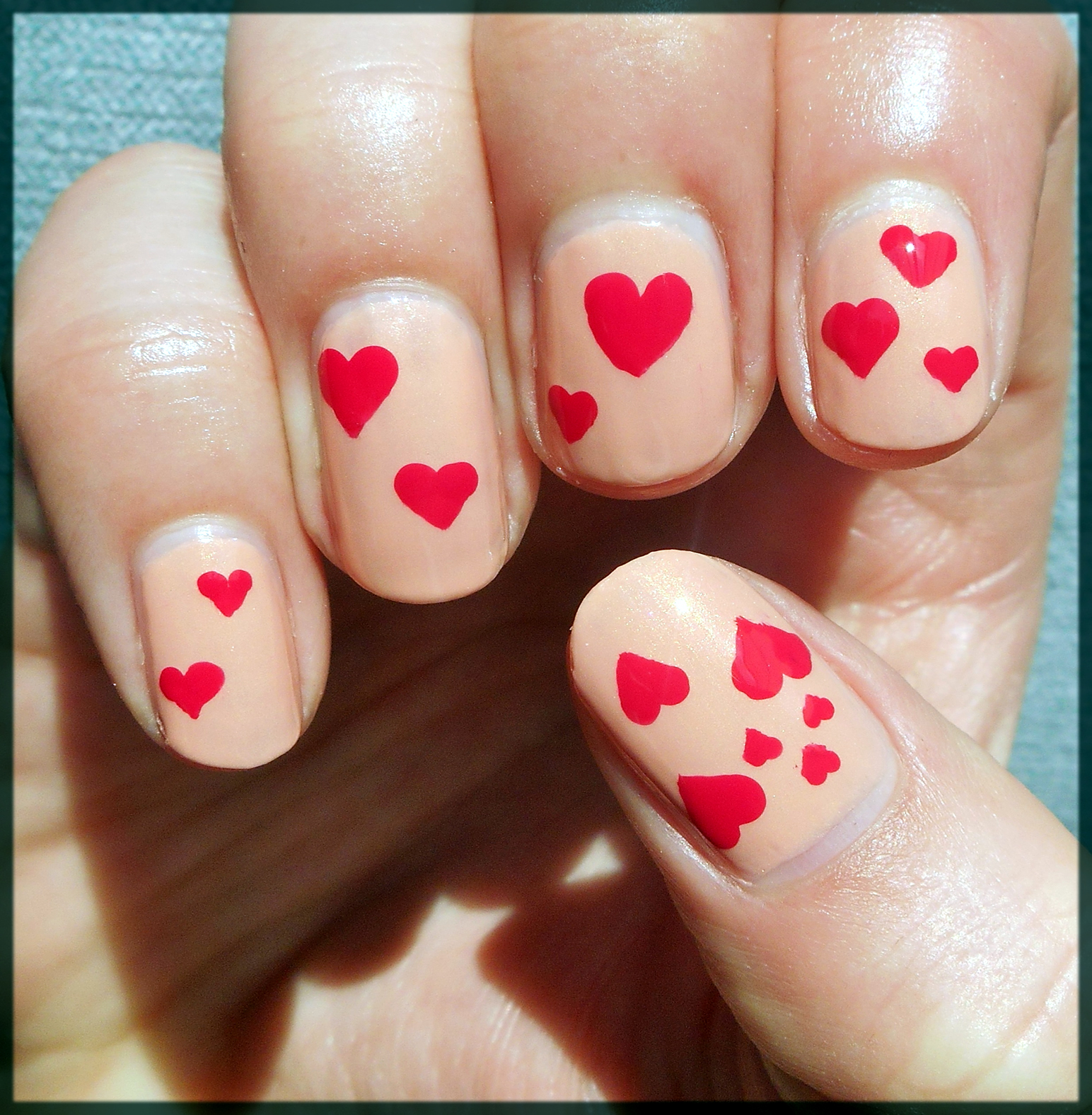 simple red hearted nail art design