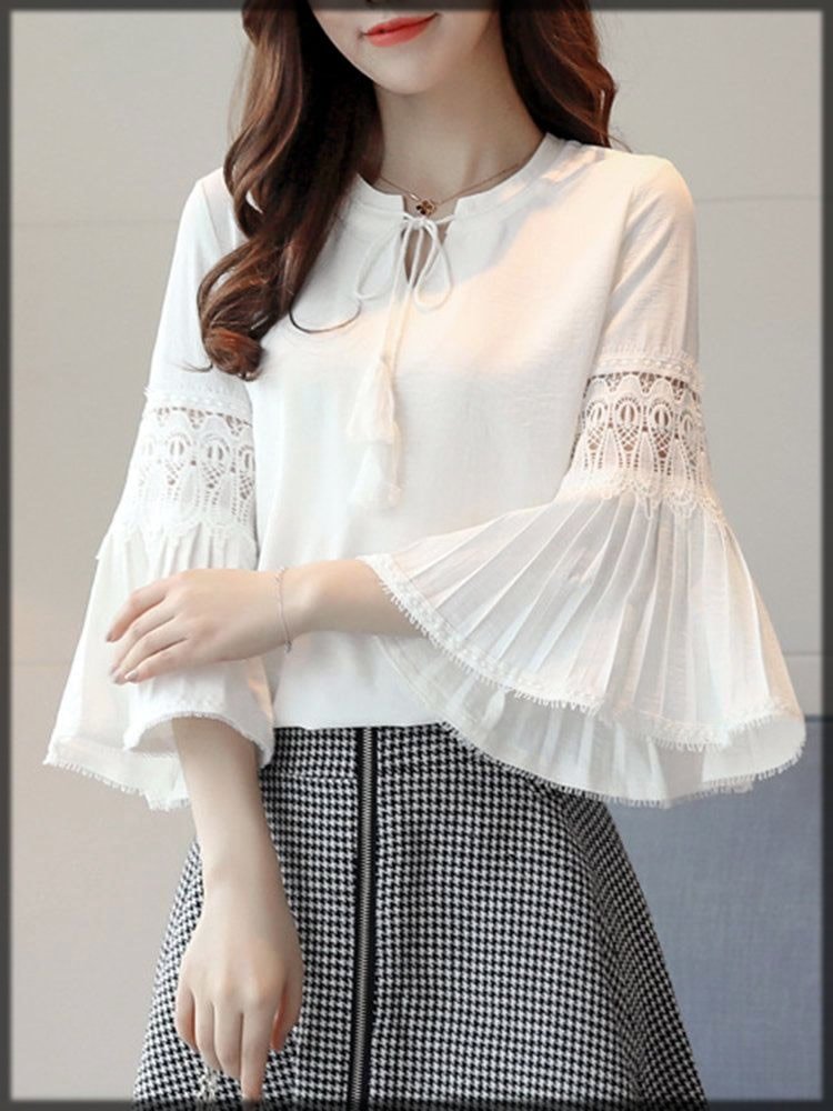 white top with flowy sleeves