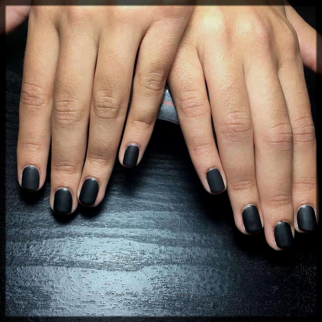 sleek black fall winter nail color