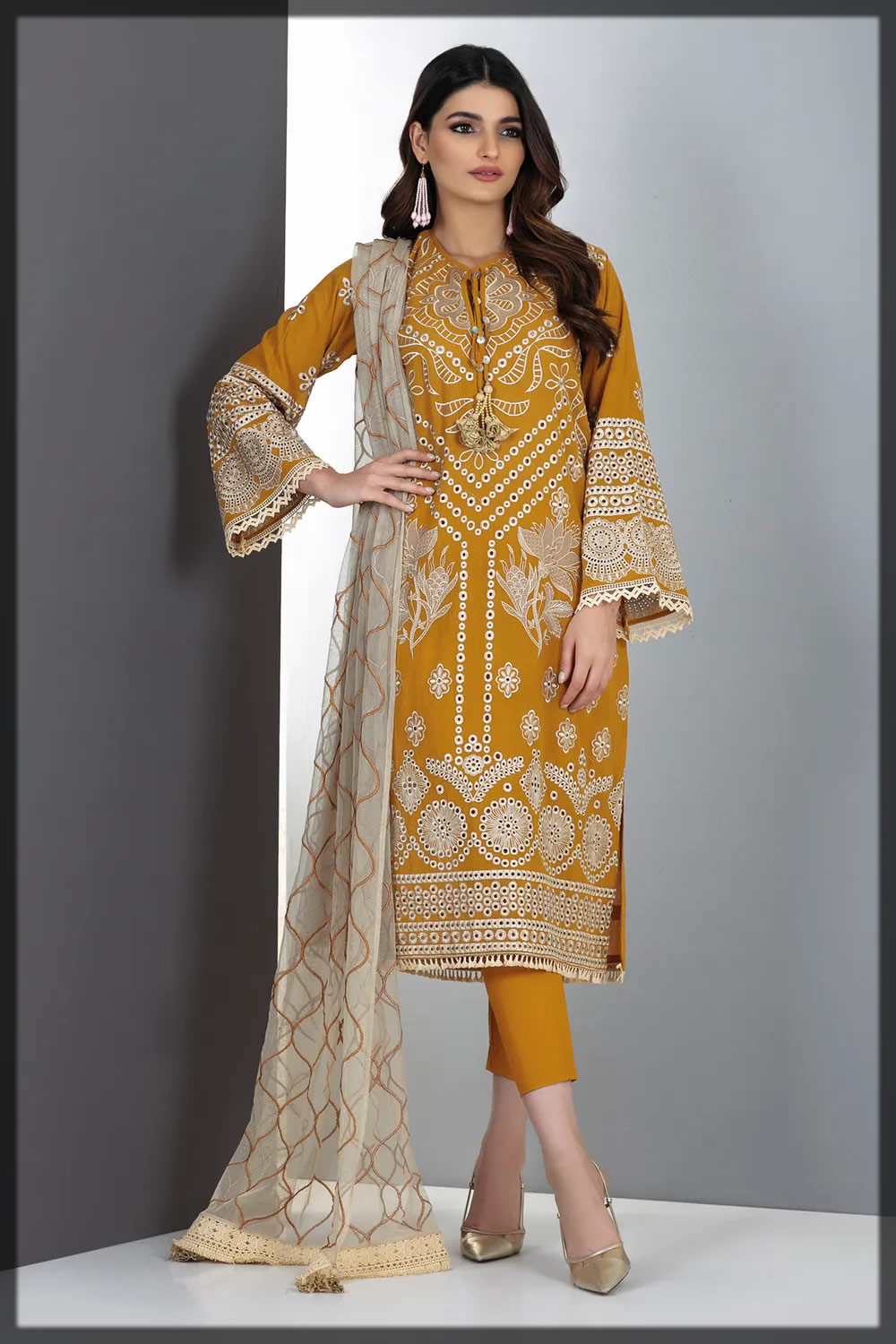 alluring mustard embroidered lawn suit