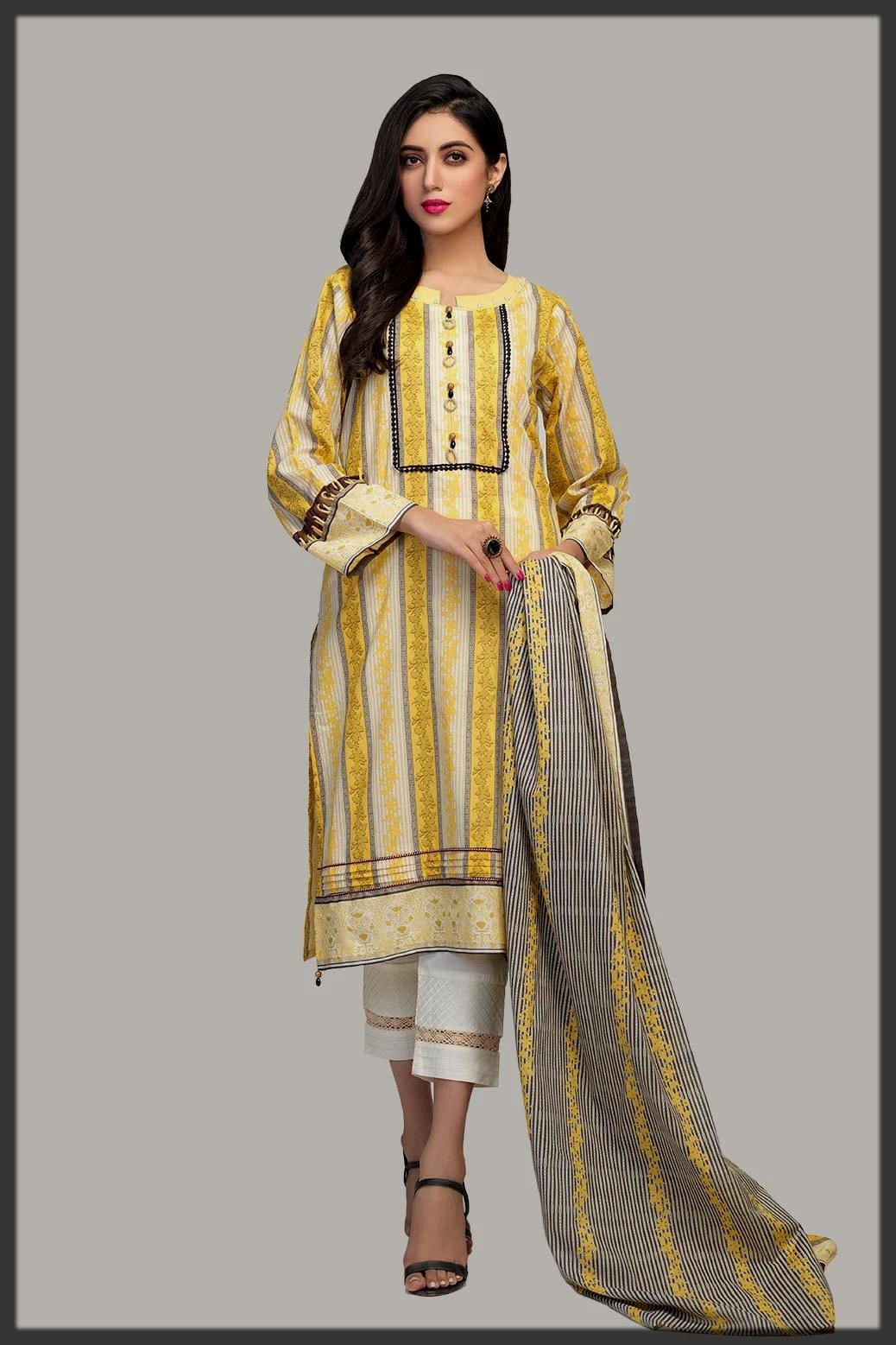 stunner yellow 2pc suit by bonanza