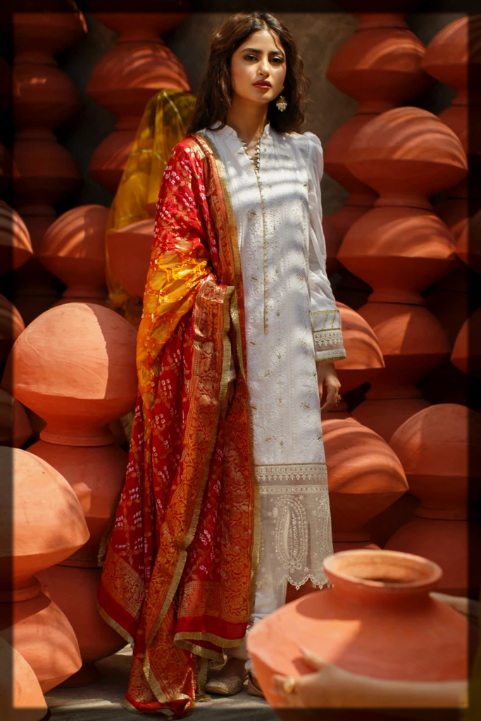 white and red luxury lawn suit by qalamkar