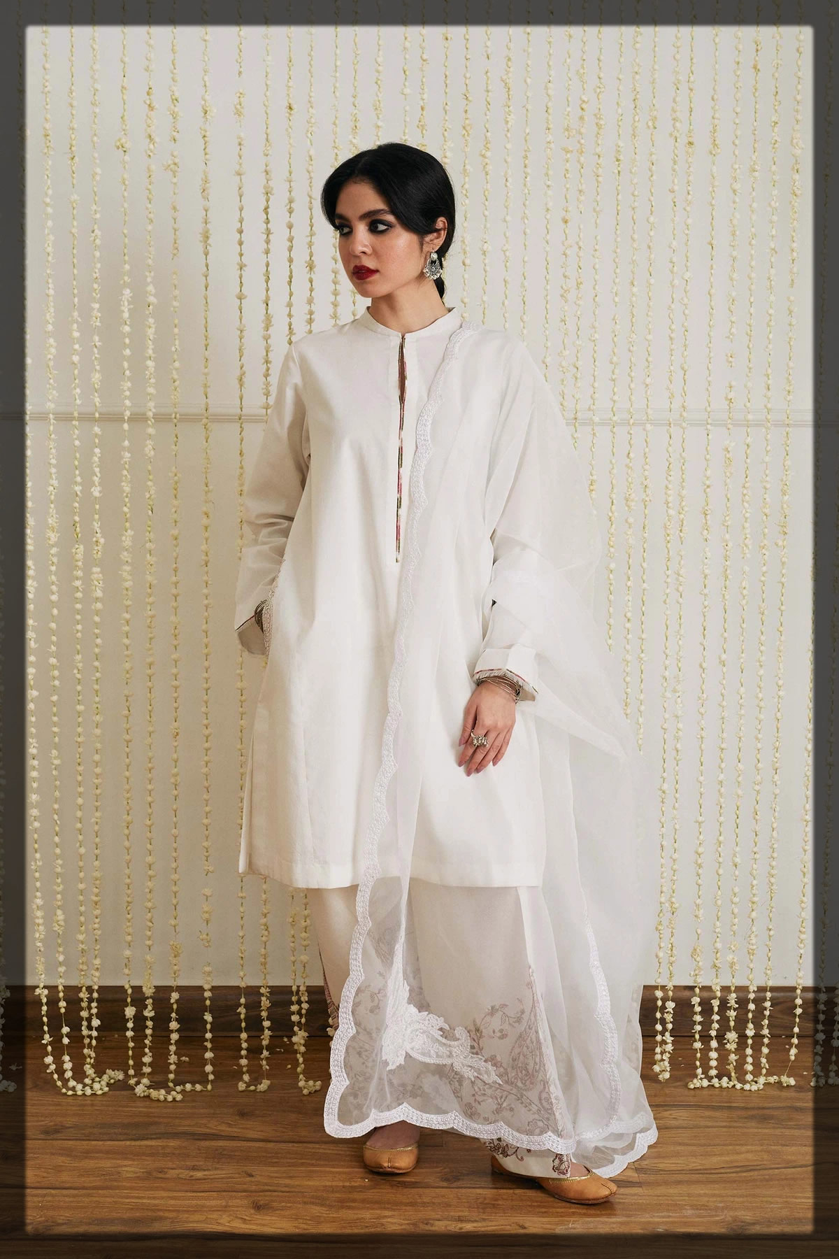 White loose-fit kurta with embroidered motif