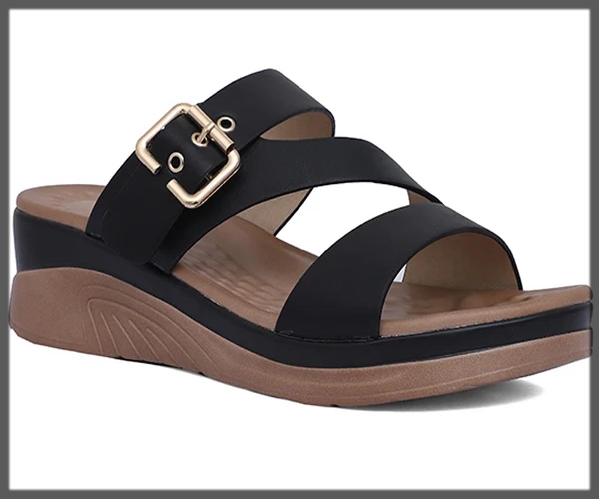 black buckled slippers