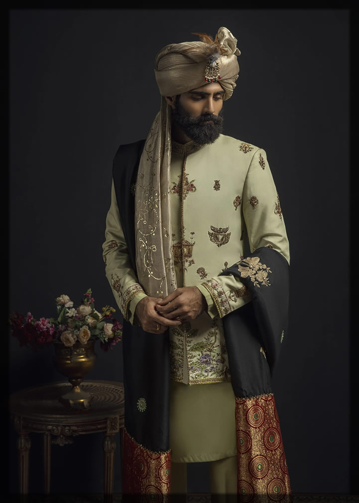 heavily embroidered cream prince coat with shawl