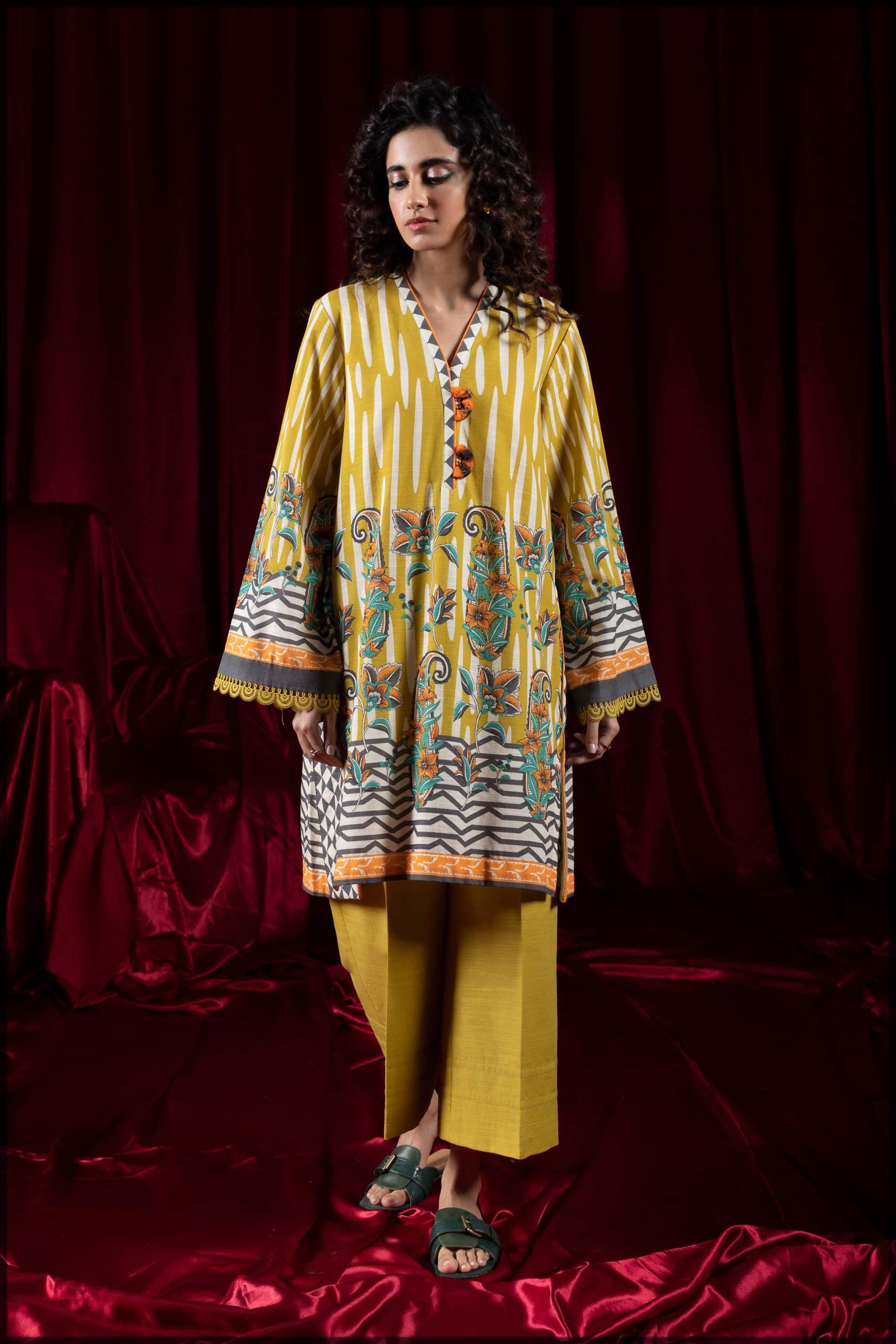 yellow two-piece printed khaddar suit