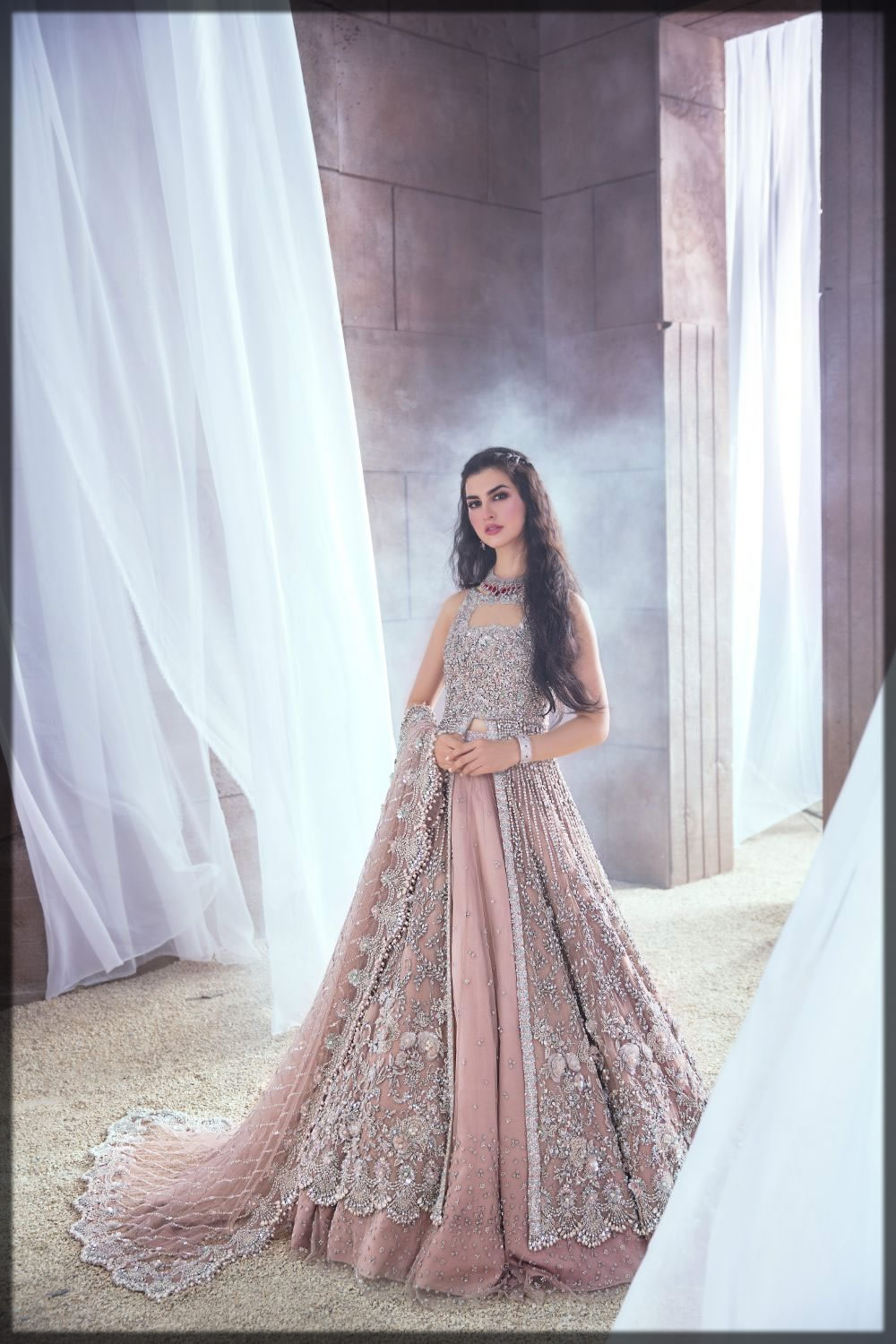 peach embellished net bridal gown